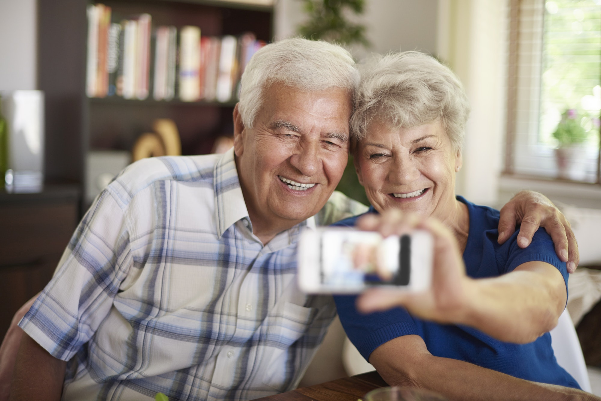 Grandparents taking a selfie with their smartphone