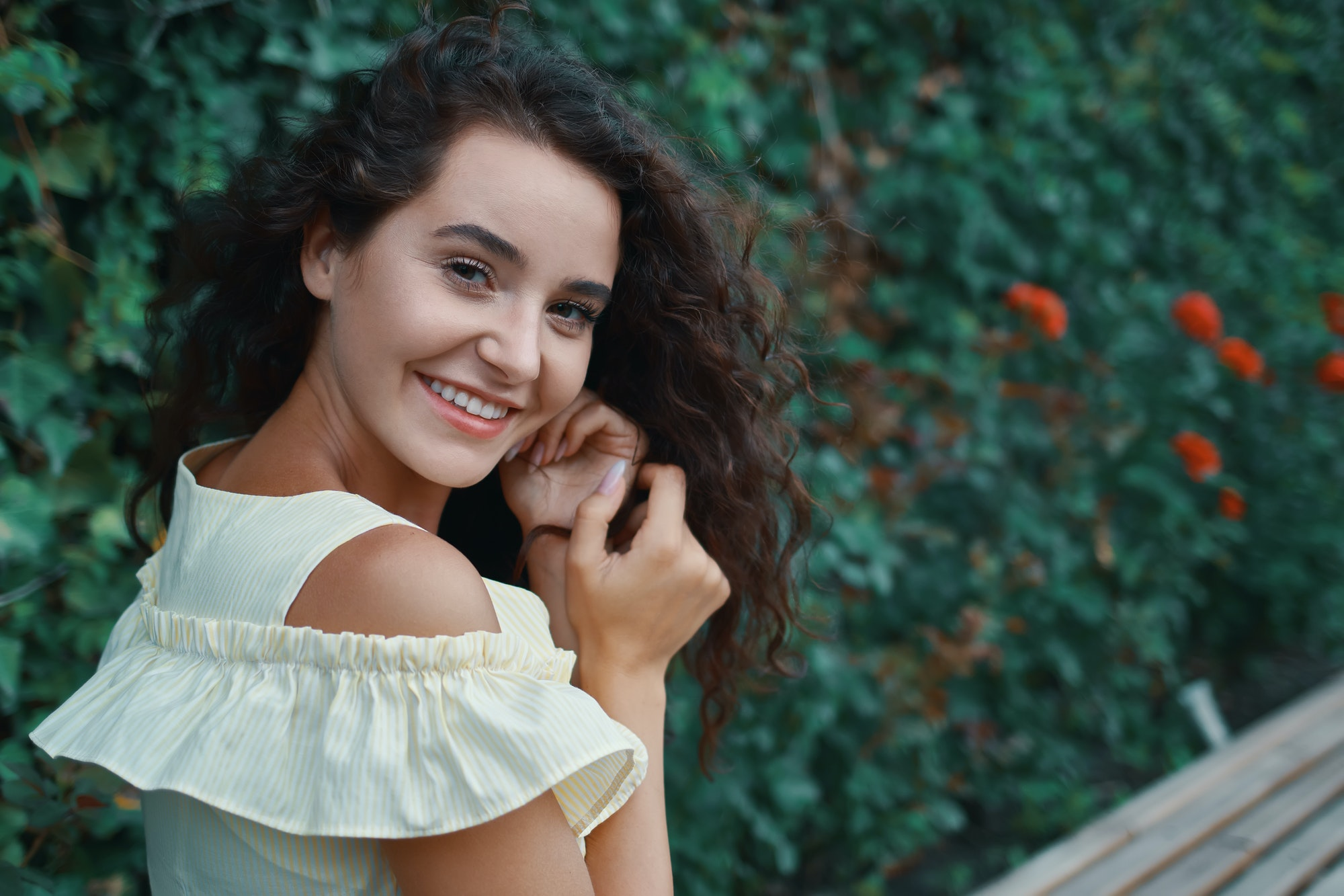Romantic young woman with an adorable smile